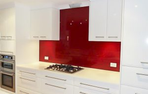 Kitchen glass splashbacks in red crimson colour