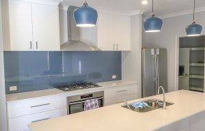 Glass splashbacks in darker blue colours