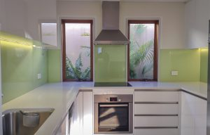 painted glass splashbacks in green colour