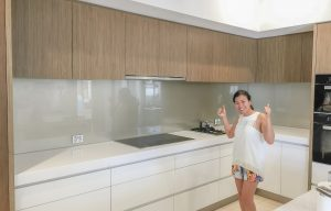 Our client being very happy with her new kitchen metallic glass splashbacks