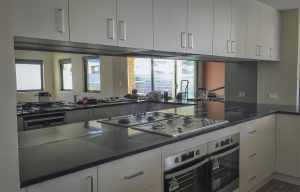 Tough mirrored kitchen splashbacks