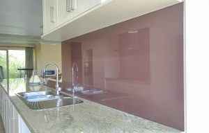 Kitchen glass splashbacks in Reds Oranges and Plum colours