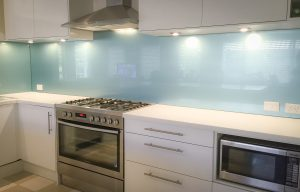 Kitchen splashbacks in Teal blue coloured glass